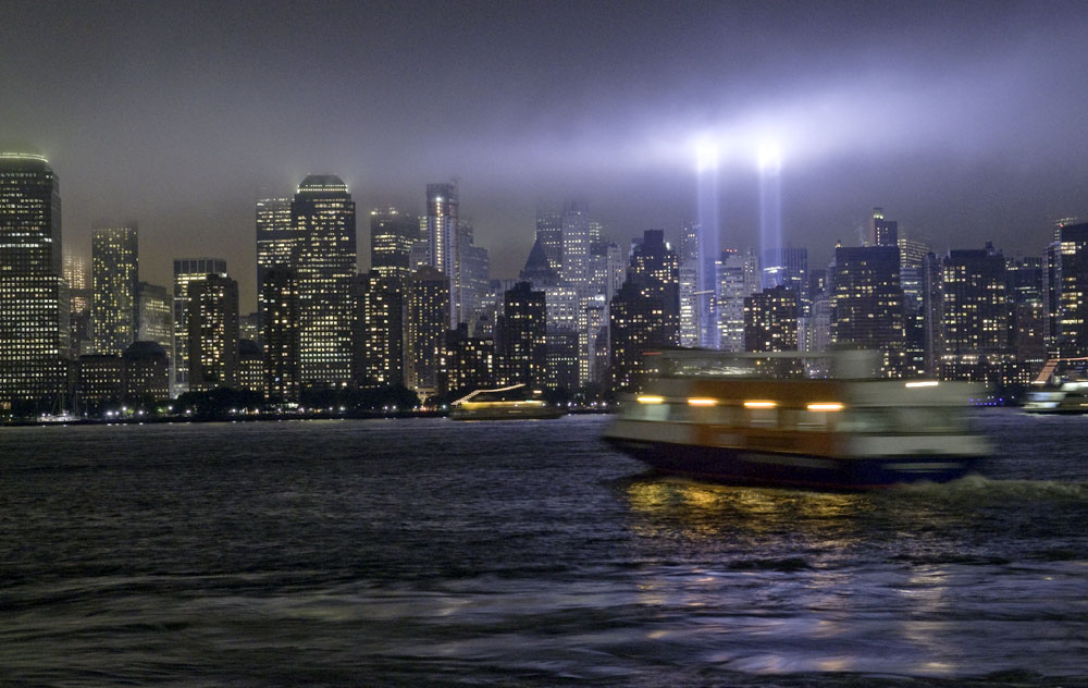 Rain over 9/11/2009 Tribute Lights. Photo by Alina Oswald.