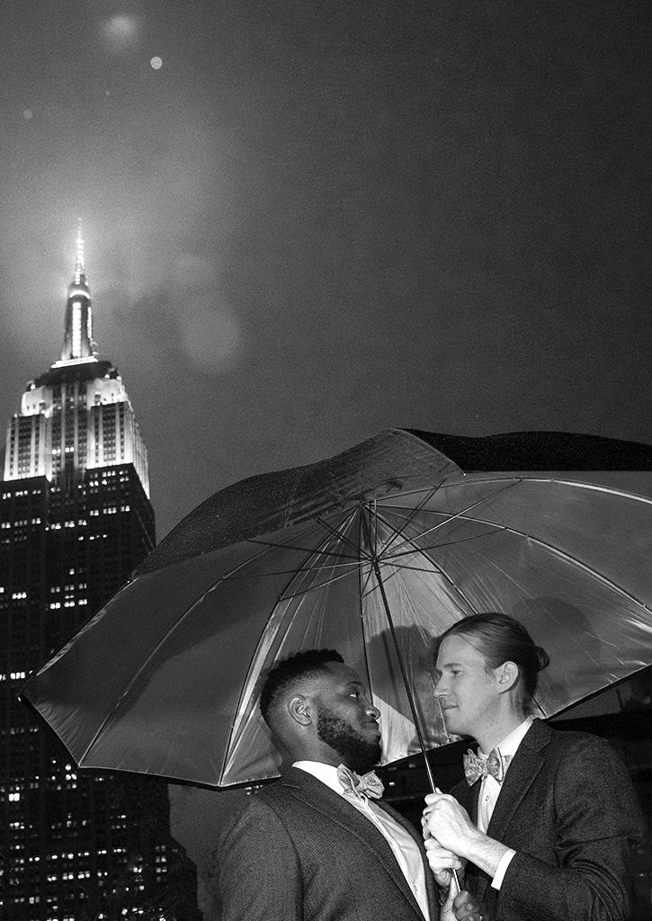 Newlyweds under the city lights. Photo by Alina Oswald.