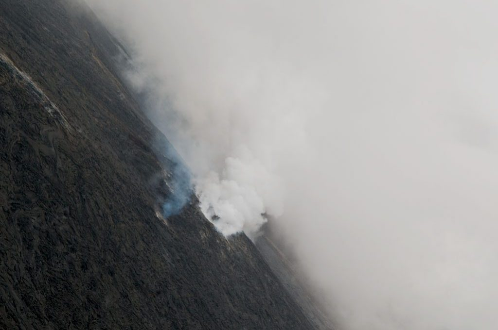 Aerial photography of smoking lava fields of Hawaii. Photo by Alina Oswald.