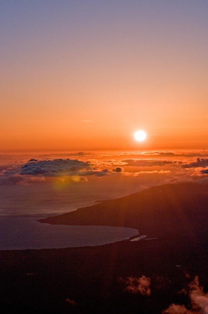 Watching the sunset from above the clouds. Haleakala National Park. Maui, Hawaii. Photo by Alina Oswald.