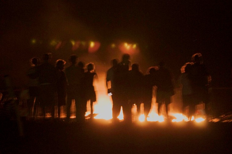 People silhouetted by lava glow. Photo by Alina Oswald.