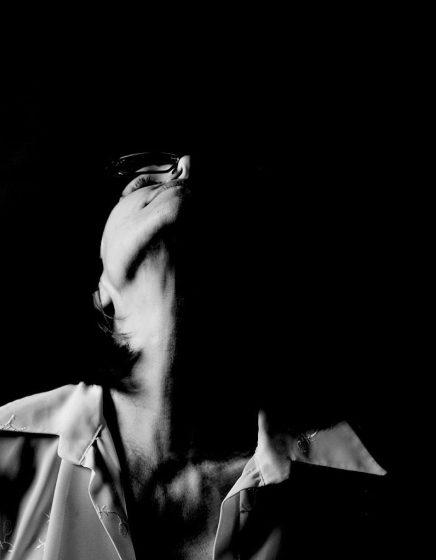 Split Light - A Self-Portrait by Alina Oswald.