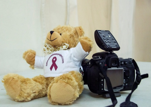 Behind the scenes shots with Dab the AIDS Bear, at the HIV Warriors photo shoot. Photo by Alina Oswald.