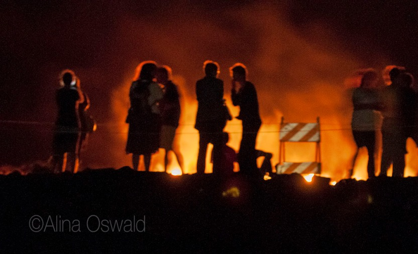 People silhouetted by live lava. Big Island of Hawaii. Photo by Alina Oswald.