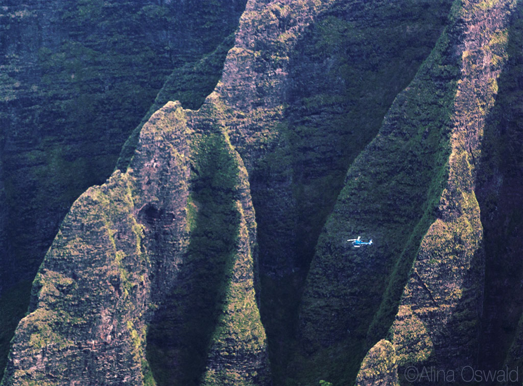 Helicopter flying over Napali Coast. Aerial Photography by Alina Oswald. All Rights Reserved.