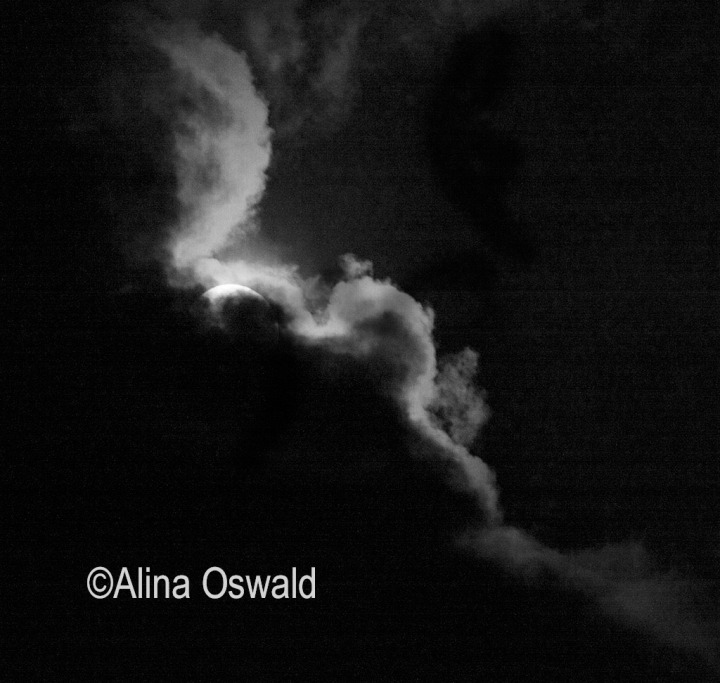 Clouds cover the solar eclipse of August 21, 2017. Photo by Alina Oswald. All Rights Reserved.