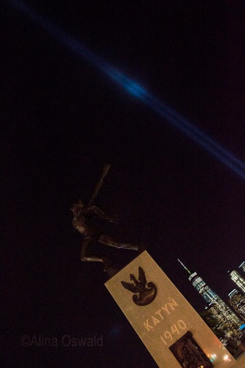 The Katyn Memorial and 9/11 Tribute Lights photographed on September 11, 2017 by Alina Oswald. All Rights Reserved.
