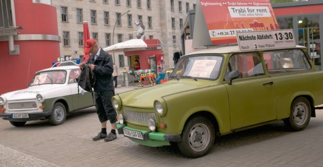 Customer at Rent-a-Trabi station, next to the ruins of Berlin Wall, Germany.