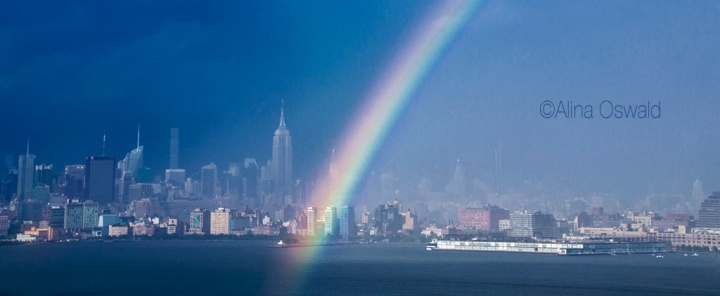 Rainbow over Manhattan skyline on a stormy day. Photo by Alina Oswald.