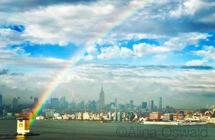 Rainbow crosses the Hudson River, from Jersey City to New York City. Photo by Alina Oswald. All Rights Reserved.