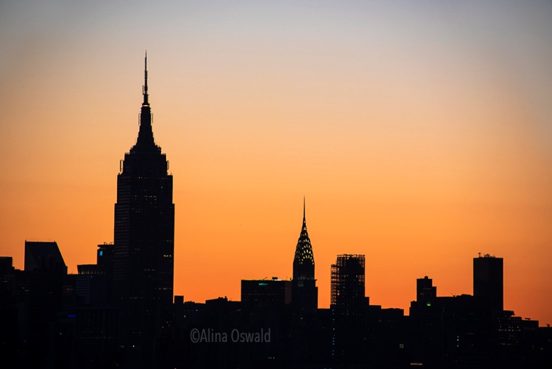 Sunrise light silhouettes Manhattan skyline. A closer look. Photo ©Alina Oswald. All Rights Reserved.