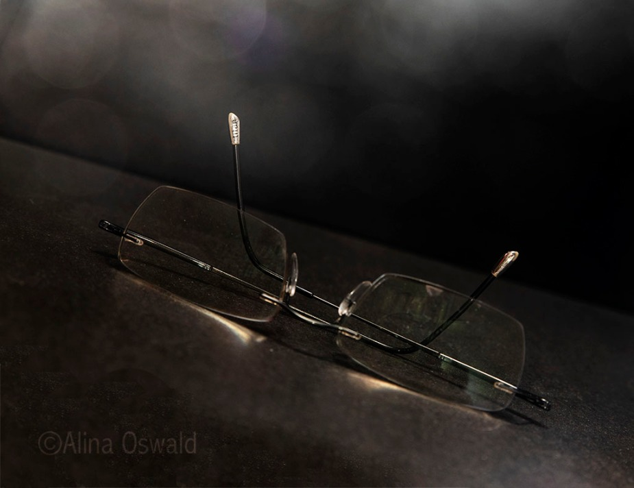 Dirty glasses in the dark. Photo by Alina Oswald.