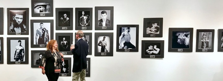 Kurt Weston with guest at the opening of his show, Remember: An AIDS Retrospective