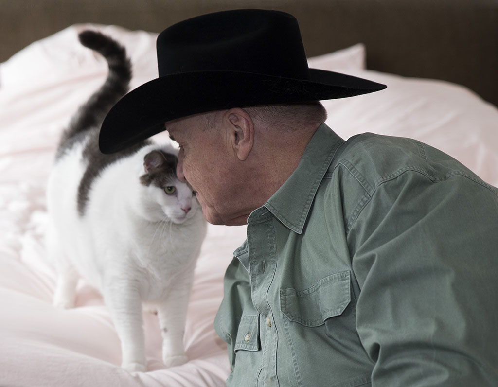 Advocate David Mixner and one of his cats. Photographed by Alina Oswald for A&U Magazine--America's AIDS Magazine.