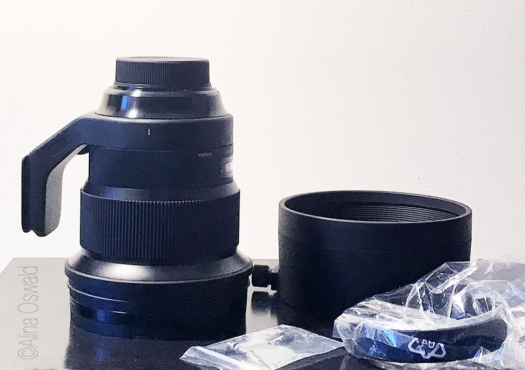 Sigma 105mm f/1.4 for Nikon with accessories. Photo by Alina Oswald. All Rights Reserved.