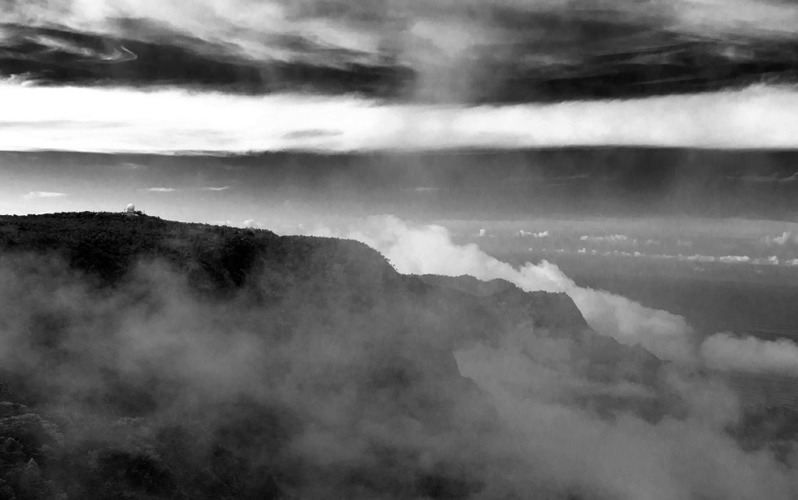 Napali Coast Observatory seen through fog and clouds. Black-and-White photography by Alina Oswald.