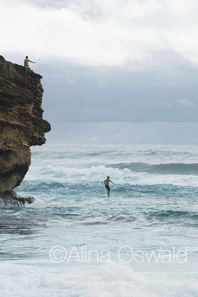 Fun in Hawaii. Jump off the cliff. Photo by Alina Oswald. All Rights Reserved.