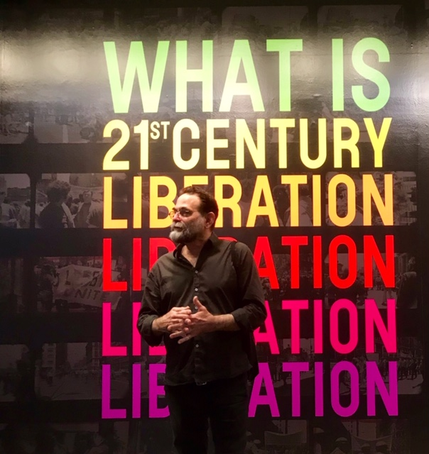 Artist and activist Avram Finkelstein, at the What Is 21st Century Liberation broadsheet launch party in NYC. Finkelstein co-designed What Is 21st Century Liberation broadsheet for Visual AIDS. Printed copies of the Broadsheet will be distributed by Visual AIDS during Pride March. Photo by Alina Oswald.