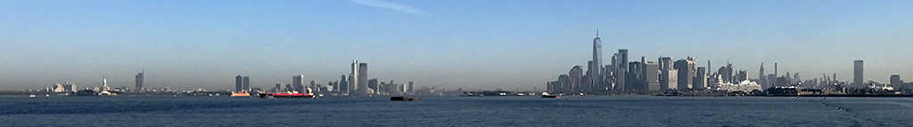 Jersey City and Manhattan skylines as seen from NY Harbor. Photo by Alina Oswald.