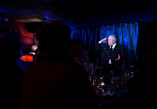 """NYC Actor/Comedian Steve Hayes performing his one-man show, Steve Hayes With A """"Hitch"""" at Pangea, in NYC. Photo by Alina Oswald. All Rights Reserved."""