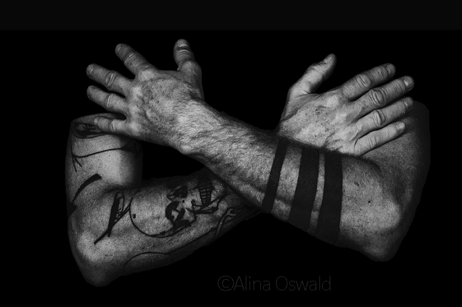 Power. Empowering Tattoos. B&W hand portrait by Alina Oswald.