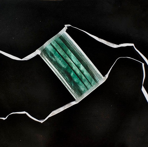Green Surgical Mask. Photo by Alina Oswald.