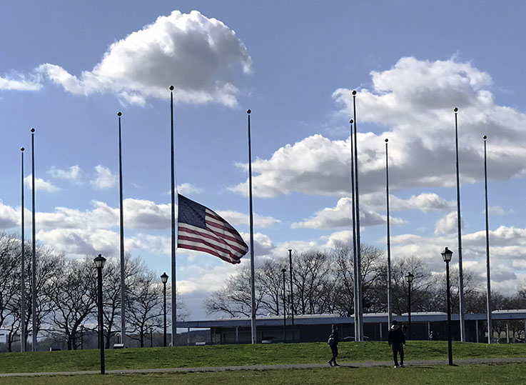 Flags at half staff in Liberty State Park, NJ, during coronavirus pandemic, shortly before the park was closed to the public.