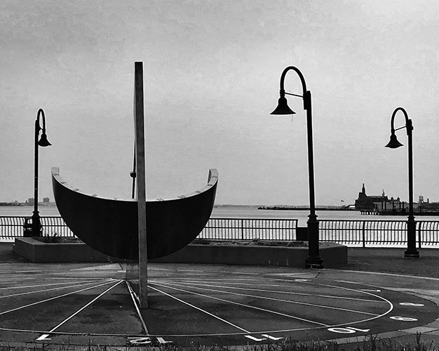 Sundial on Jersey City Waterfront in black and white. (How do you measure a month in a life defined by Coronavirus