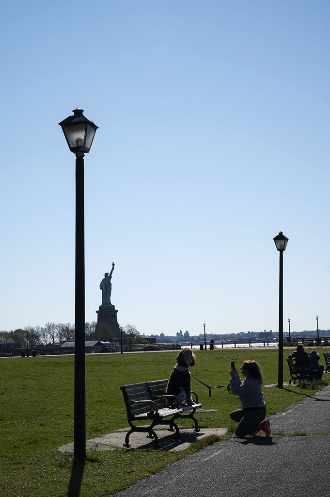 Cute Dog Moments: A lady takes a snapshot of her cute dog in Liberty State Park. ©Alina Oswald.