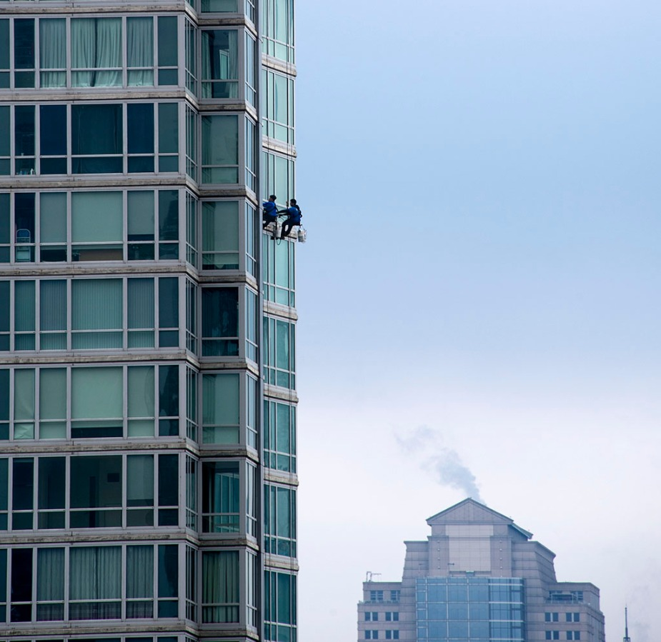 Window cleaning in a time of Covid-19. Upon zooming in, it looks like they're wearing masks. ©Alina Oswald.