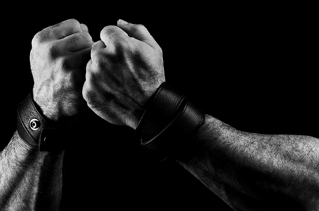 Act up. Fight Back. Hand portrait in black and white by Alina Oswald.