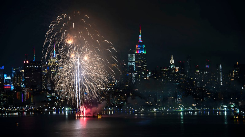 NYC Pride 2020 fireworks next to a rainbow-lit ESB during NYC Pride 2020 evening. ©Alina Oswald.