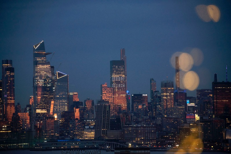 NYC after sunset, seen through a foreground bokeh of Christmas lights. ©Alina Oswald. All Rights Reserved.