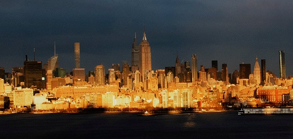 "Panoramic image of Manhattan skyline at sunset, displaying ""I Want to Thank You"" sign. ©Alina Oswald. All Rights Reserved."