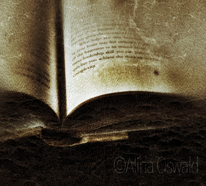 An open book in sepia tones. ©Alina Oswald. All Rights Reserved.