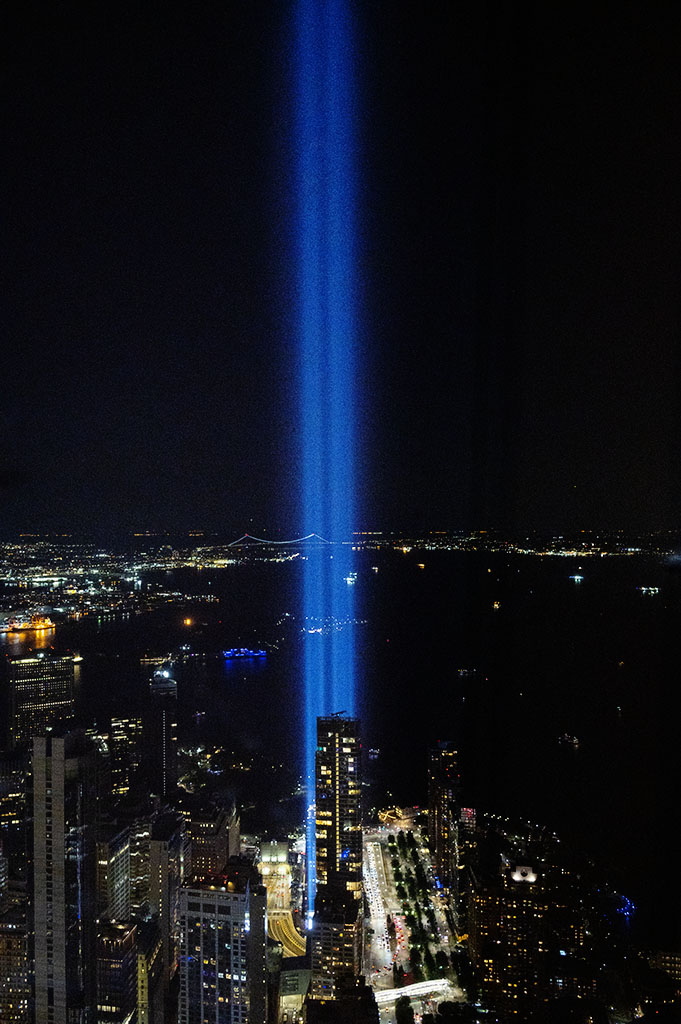 September 11 Tribute Lights over NYC and NY Harbor as seen from One WTC Observatory on 9/11/2021. ©Alina Oswald.