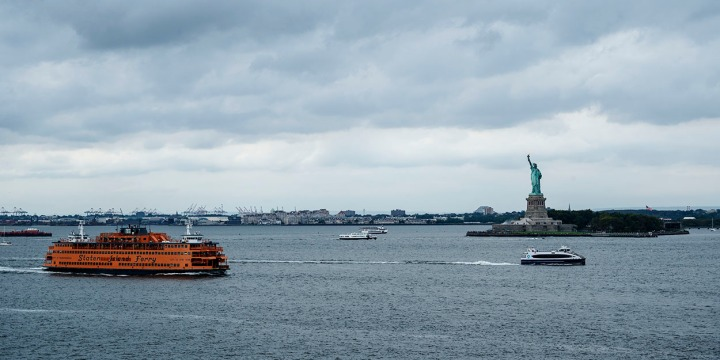 The Staten Island Ferry sails by Lady Liberty